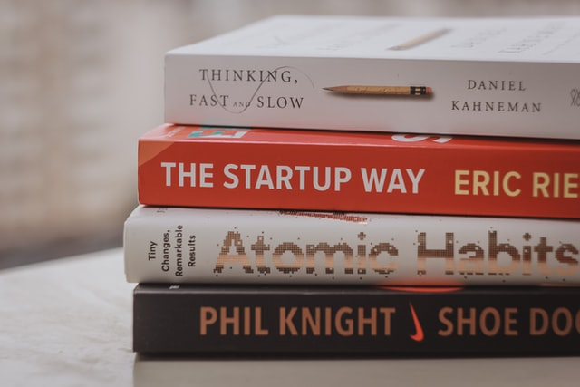 Pile of books about start-up salaries