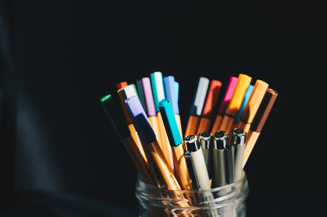 Pot of pens to study for insurance and risk management qualification