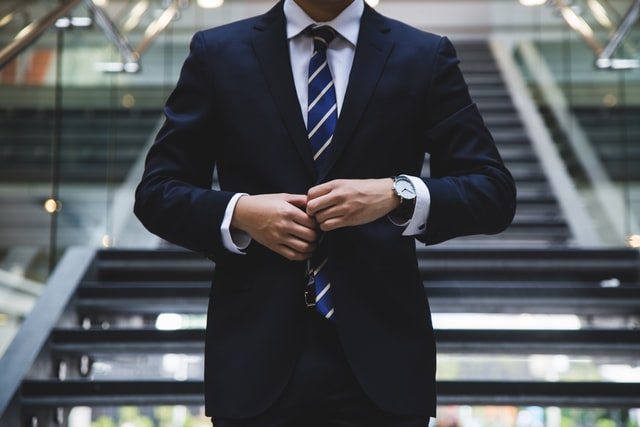 A person in a suit symbolizing sales salaries